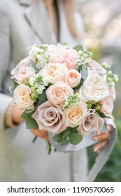 spring mood. Young girl holding a beautiful wedding bouquet. flower arrangement with white and Pastel color flowers.