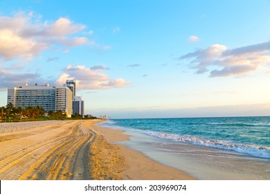 Spring morning at the ocean beach. Miami Beach at sunrise with resorts in a view.