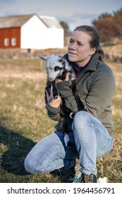 Spring is the most beautiful time of the year. Nature wakes up, and gives us new life. The photo shows a woman holding a newborn lamb. The photograph was taken at Frøya, in Norway.