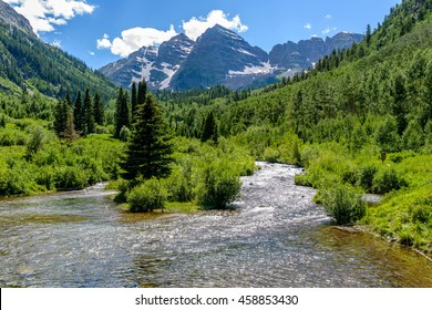 Spring Mountain Creek - Spring snow-melting water running down Maroon Creek at base of Maroon Bells, Aspen, Colorado, USA.