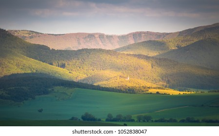 Spring mountain hills. Green valley and mountain forest in morning sunlight.