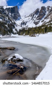 Spring Mountain Lake - A wide-angle vertical view of Hallett Peak and Flattop Mountain towering at shore of still-mostly-frozen Dream Lake, Rocky Mountain National Park, Colorado, USA.