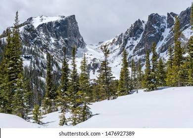 Spring Mountains - A closeup view of Hallett Peak and Flattop Mountain, surrounded by snow and forest, in Rocky Mountain National Park, Colorado, USA.