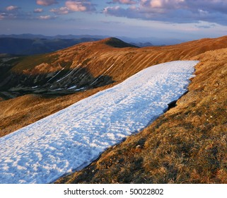 Spring in mountains and last snow. The Ukrainian mountains Carpathians