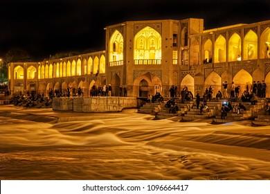 Spring night on the ancient Khaju bridge in Isfahan, Iran.