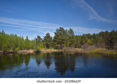 Spring on the forest river. May landscape in  national park of central Russia.