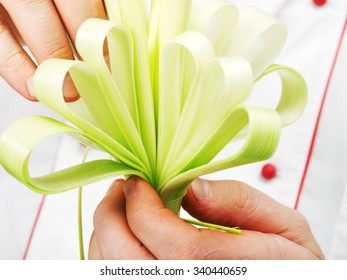 Spring onion made like flower, close up of hands and vegetable
