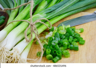 Spring onions are rich in vitamins,minerals and natural compound. Green onions or Spring onions on wooden board cutting.