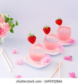 Spring  pastel pink drinks with cherry blossom syrup. 				Mother'sday or valentine's drinks.