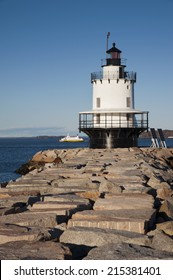 Spring Point lighthouse guides mariners, tour boats, and shipping traffic entering and leaving Maine's Portland Harbor.