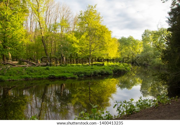 Spring in Pollok Country Park in Glasgow, Scotland. White Cart Water and Trees