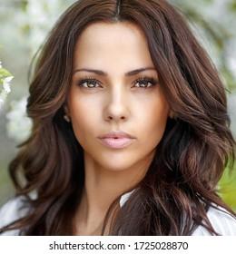 Spring portrait of cute beautiful brunette woman - close up portrait