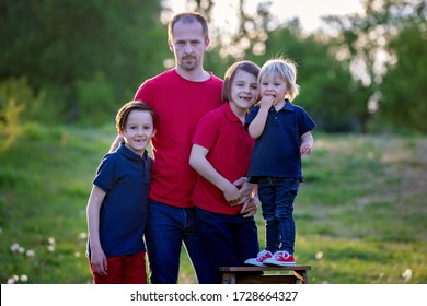 Spring portrait of happy family in nature on sunset, having fun together