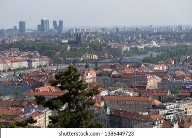Spring Prague City with fortress Vysehrad and green Nature with flowering Trees from the Hill Petrin, Czech Republic