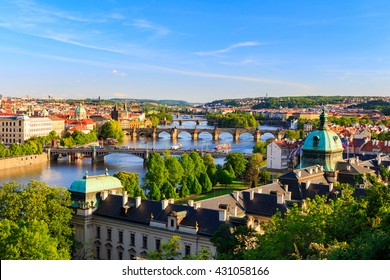 Spring Prague panorama from Prague Hill with Prague Castle, Vltava river and historical architecture. Concept of Europe travel, sightseeing and tourism.
