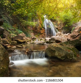 Spring rill flow. Nature waterfall composition.