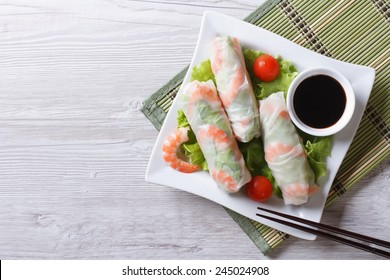 spring roll with shrimp and vegetables on a plate. horizontal view from above