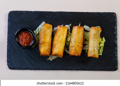 Spring roll with tomato sauce