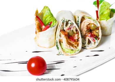 spring rolls with chicken and vegetables on a white plate