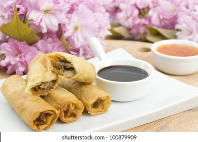 Spring Rolls - Fried duck spring rolls served with soy sauce and sweet chili sauce.