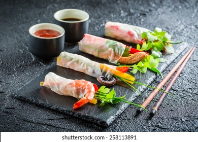 Spring rolls with vegetables, seafood and sauce