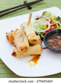 Spring rolls with vegetables, sweet mango chili sauce. Asian cuisine Outdoor background