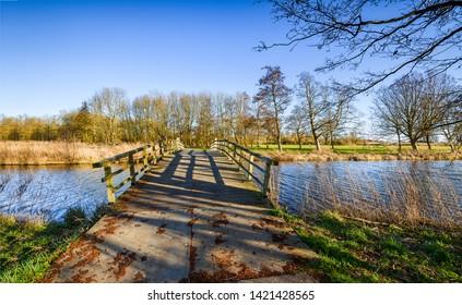 Spring rural river bridge landscape. Rural river bridge view. River bridge in spring. Village river bridge landscape