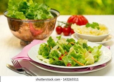 Spring salad with early vegetables and Tete de Moine cheese