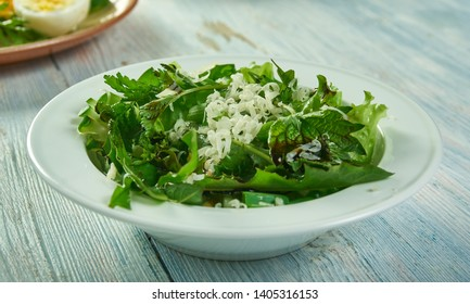 Spring salad with herbs, dandelion, nettle and cheese, vlose up