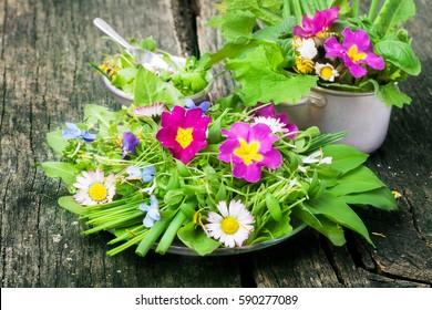 Spring salad, wild herbs, edible flowers