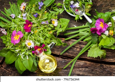 Spring salad - wild herbs, edible flowers and oil