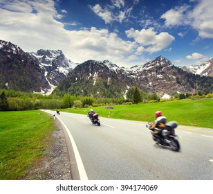 Spring scene in the Swiss Alps. Riding on motorcycles in the mountain pass. Switzerland, Europe.