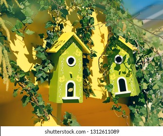spring season. bright beautiful birdhouses. spring garden decor. birdhouse hangs on leafy green tree on beautiful spring or summer day