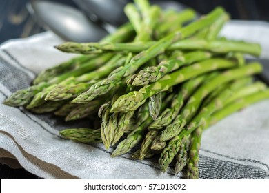 Spring season - fresh white and green asparagus on linen napkin