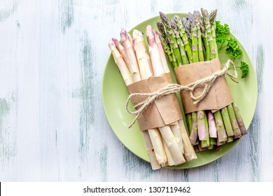 Spring season, new harvest of Dutch, German white and green asparagus, bunch of raw green and white asparagus