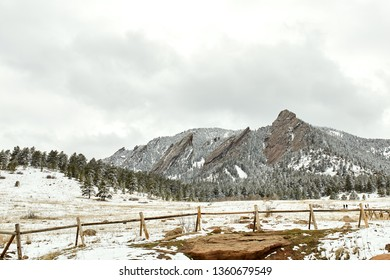 A Spring snow storm covers the mountain range, forest, valley and Flatirons of Chautauqua Park in snow.  Boulder, Colorado.