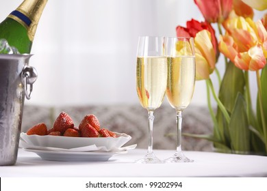 Spring still life with champagne  wine , strawberries and tulips