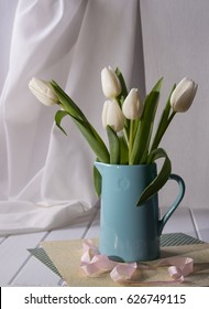 Spring still life with white tulip