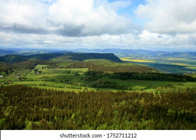 Spring Stolowe Mountain range- landscape near small, picturesque Pasterka village in Poland. Famous tourist attraction. Oldest mountains in Europe. View from Szczeliniec Wielki, Great Szczeliniec.