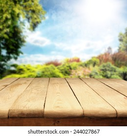 spring or summer background of garden and wooden old table space of free