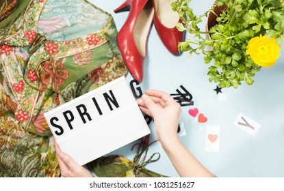 Spring summer fashion look with floral prints, red shoes, ranunculus flower, text frame Spring summer fashion look with floral prints, red shoes, ranunculus flower, text frame