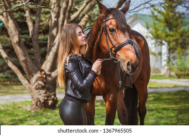 Spring - summer season, concept of hobby, Woman with a horse on a nature, relationship human and animals