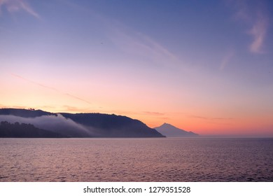 spring sunrise on the sea in greece at holy mount athos