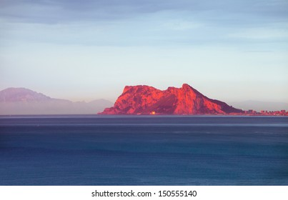 Spring sunrise over Gibraltar rock southern Spain (Africa at far horizon)