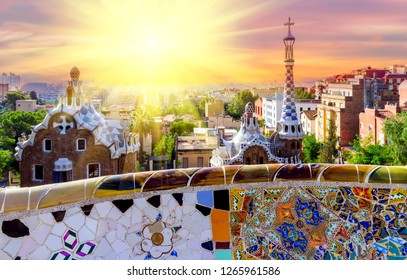 Spring sunset Park Guell is a public park  located on Carmel Hill, bench covered with tile-shard mosaic, Barcelona, Spain.