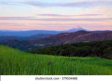 Spring sunset from Roxy Ann Mountain in Medford, Oregon showing a distant Mount McLoughlin in Southern Oregon.