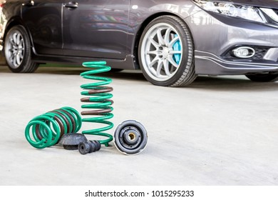 Spring suspension with seal rubber part and blur car background for texture and copy space service concept