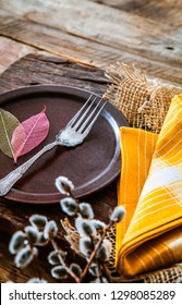 Spring table setting. Cutlery on wood. Fork in plate