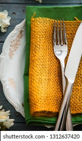 Spring table setting. Narcissus flower. Fork on Easter table. Holiday table setting