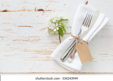 Spring table setting with white flowers, copy space